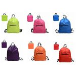Variour colour view of a folding drawstring backpack.